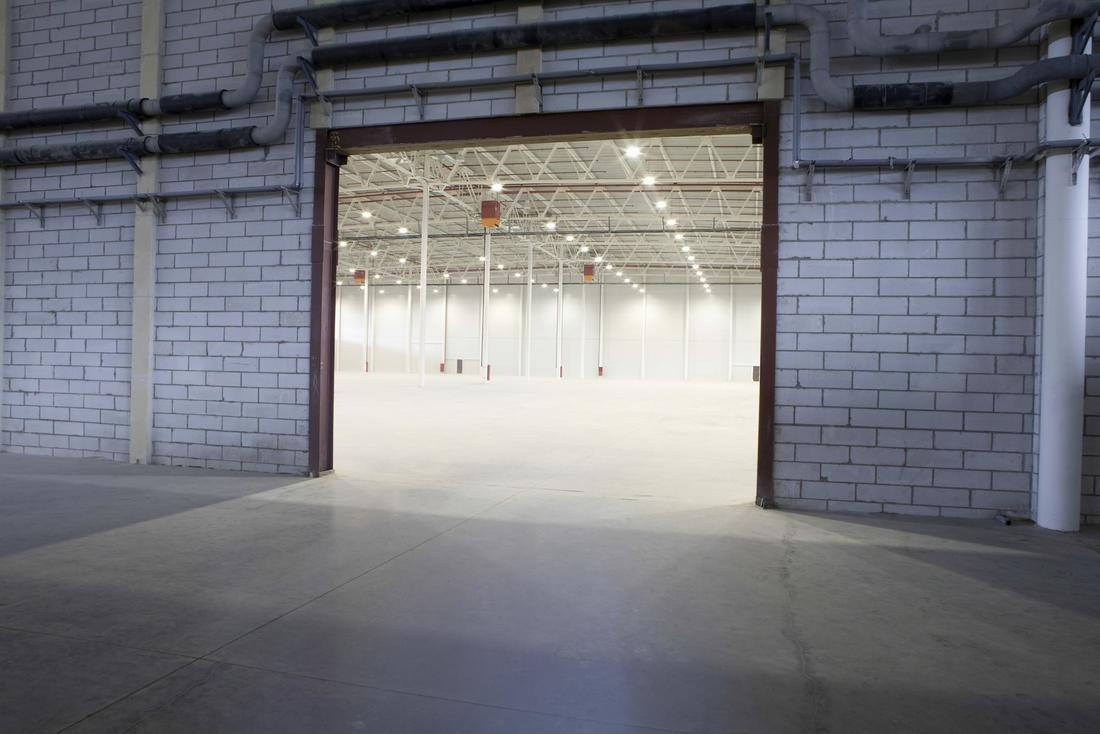 Picture of finished concrete floor on the inside and outside of large industrial building